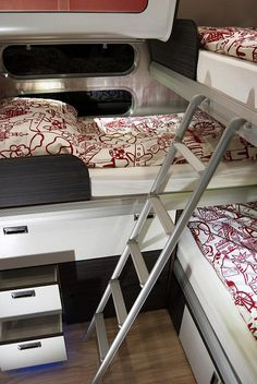 The bedroom uses an innovative triple bunk configuration. Airstream deserves a pat on the back for their 685 model!