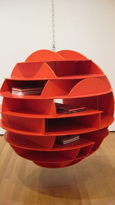 a suspended sphere o' shelves… dream storage.