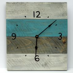 """Pallet wood clock from reclaimed wood. 16"""" wide and 18"""" tall. clock motor runs on a AA battery. Available on my Etsy site. Custom colors and sizes available. This is the start of many pallet clocks."""
