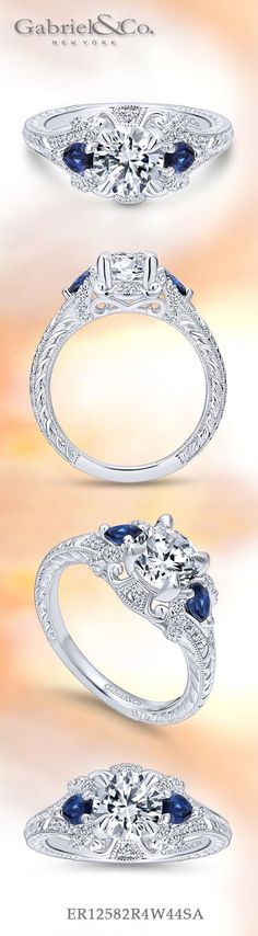 Gabriel & Co. - Voted #1 Most Preferred Bridal Brand. An antique-style engagement ring's grand halo features a pair of sapphire side stones in addition to diamonds and romantic white gold.