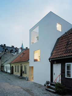 Modern Minimalist Townhouse That is Stucked Between Very Old Neighbors
