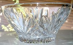 Elegant vintage crystal bowl with palm leaf pattern, ribbed bottom, star burst center. I took the photos outdoors so you could see how it sparkles
