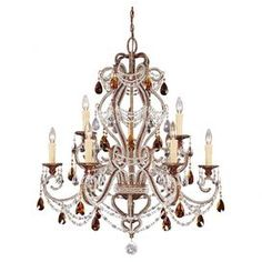For an opulent scheme, this stunning five light chandelier features clear and amber crystal droplet detailing and a gold finish. Channel French elegance by teaming with a gilt leaf mirror and velvet upholstered furniture.  Product: ChandelierConstruction Material: Metal and crystalColour: GoldFeatures: Droplet detailing Made in Spain Accommodates: (5) 40 Watt G9 halogen bulbs - includedDimensions: 127 cm H x  85 cm Diameter