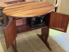 Reproduction oval Singer Featherweight Cabinet:  I would love one!!