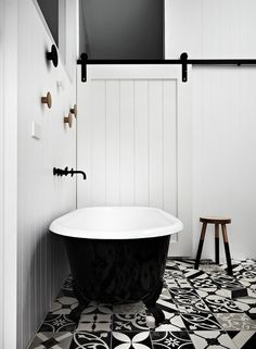 Black and white bathroom, with mixed printed floor tiles