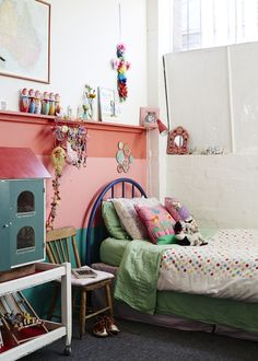 Mabel's room, including Priscilla's childhood bed which is now her daughter's, and doll house from the Mill Market in Geelong. Photo - Sean Fennessy. Production – Lucy Feagins / The Design Files.