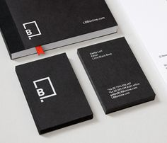 Little Black Book business card with black board and white foil detail designed by Freytag Anderson.