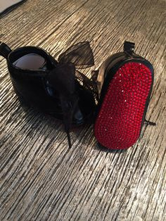 as seen on Cocos daughter Chanel!!!!  Red Bottoms for your baby! These are INSPIRED by the Louboutin red bottom pumps!  Available in Mary Janes or high tops I also can do these in White with a bow w/ silver trim , or black patent with a leopard bow . Even more sparkly in person