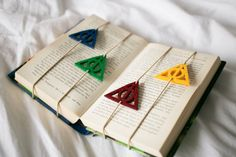 We present to you set of 4 Harry Potter bookmarks. Only for a true HP fans! Each one is a Deathly Hallows Symbol in different color (Red, Yellow, Green, Blue)  Bookmarks are made of thick felt (0.4cm thick) with beige elastic.  Set of 4 Harry Potter Bookmarks is perfect for a gift! Surprise your friends and family with them :)  ------------------------- Please note, that: *Price is for set of 4 bookmarks. *Size: 5 cm (2 inches) -------------------------  *If you have any questions, please…