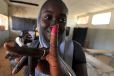 A woman displays her inked finger after voting at a polling station in Fatick, Senegal. Senegalese voted in a run-off election in which the 85-year-old incumbent Abdoulaye Wade is fighting off a mass opposition effort to foil his controversial bid to stay in power for a third term. (Issouf Sanogo, AFP / Getty Images)