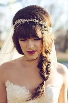 Blunt bangs with a fishtail braid, red lips and a beaded bridal headband with veil for a modern bride.