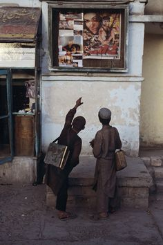 Young men admiring movie poster, Pul-i-Khumri, Afghanistan    Steve McCurry