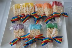 Rice Kripie treat paintbrush treats (made by putting a wooden ice cream spoon in a pre-made Rice Krispie treat and dipping them in candy colored melts, stand up on parchment in the fridge to set)