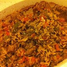 Vegetarian Jambalaya With Onions, Chopped Celery, Green Pepper, Fresh Mushrooms, Olive Oil, Garlic Cloves, Fresh Tomatoes, Water, Long-grain Rice, Reduced Sodium Soy Sauce, Fresh Parsley, Salt, Paprika, Cayenne Pepper, Chili Powder, Pepper, Reduced-fat Sour Cream