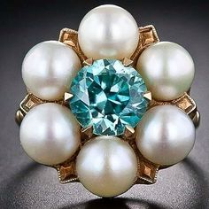 A big, bright and beautiful mid-century bauble in glorious blue and white. This unique ring, circa showcases an electric blue zircon embraced all around by six shimmering cultured pearls, supported by an artfully sculpted Retro 14 karat yellow gold Antique Rings, Vintage Rings, Antique Jewelry, Vintage Jewelry, Blue Zircon, Diamond Are A Girls Best Friend, Vintage Engagement Rings, Gemstone Rings, Pearl Rings