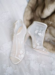 White Bella Belle stilettos: Photography : Simply Sarah Photography | Shoes : Bella Belle | Wedding Dress : Claire Pettibone Read More on SMP: http://www.stylemepretty.com/2017/02/23/jackson-hole-winter-vow-renewal/