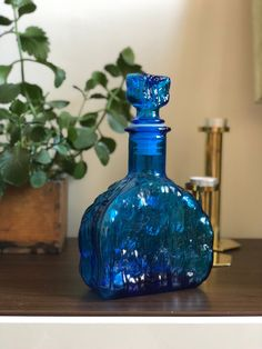 Excited to share this item from my #etsy shop: Italian blue Empoli glass decanter / carafe made in Italy with stopper and original sticker Carafe, Decanter, Tree Bark, Vintage Italian, Brutalist, Mid Century, Italy, Etsy Shop, Stickers