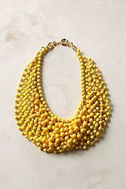 bold yellow ball necklace... I am picturing this paired with a royal blue dress. :)