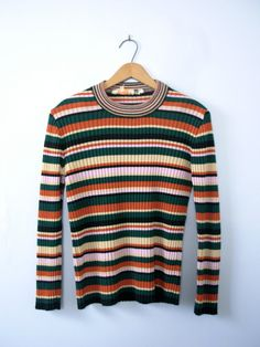 One vintage 1970s striped top, striped tee, striped shirt, striped sweater, ribbed knit, size medium / large  - Crew neckline. - Ribbed knit fabric. - Horizontal stripes. - Color scheme: dark bluish green, sunset orange, pale yellow, pastel pink, and black.  | CONDITION | A+. Gently used vintage item.  | BRAND | Not marked. Made in Romania.  | SIZE | Marked as a womens 36 (EUR). Fit is about a womens Medium. *** PLEASE compare the measurements below to a similar item that fits you for th...