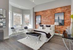schlafzimmer einrichten beispiele hellgraue wände weißer teppich ziegelwand