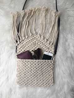 Adorable handmade Macrame crossbody with an adjustable removable strap! Perfect size for necessities! Made with 100% cotton. Measurements: 9 inches across 7 inches tall (without strap) 28 inches long with strap included Ships within 1-2 days