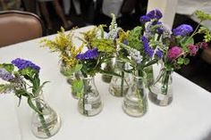 She used beakers for bud vases because Collin is a scientist. Wild Flower Arrangements, Vase Arrangements, Centerpieces, Table Decorations, Science Wedding, Erlenmeyer Flask, Bud Vases, Newlyweds, Wedding Inspiration