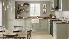 Pale enough to work as a neutral, the sage green tone of these sturdy, 20mm-thick doors makes a great choice for those that want a subtle style with plenty of country character. Choose from a wide variety of cupboards, such as larder units, which can keep cooling devices hidden from view to help maintain an uninterrupted design. Home Decor Kitchen, Interior Design Kitchen, New Kitchen, Home Kitchens, Country Kitchen Diner, Traditional Kitchen Interior, Howdens Kitchens, Traditional Kitchen Cabinets, Two Tone Kitchen