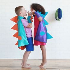 57 Perfect Kids' Halloween Costume Ideas For BFFs Dinosaur Costume Capes Dinosaur Costume Capes ($45)