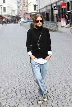 Sara Strand wears a relaxed pair of jeans with classic Converse, a turtleneck, and a boyish white button down. // #Denim