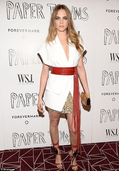 Stunning: The 22-year-old model-turned-actress wore a gold embellished skirt with a white ...