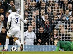 Pounce: Aaron Lennon took advantage of some poor Arsenal defending to double Spurs' lead