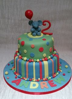 Spots and stripes colourful cake with elephant topper