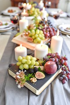 Beautiful and Bountiful Early Fall Tablescape love this idea of grapes candles Books & Wine corks to create a fall centerpiece Dining Table Decor Centerpiece, Fall Dining Table, Autumn Table, Centerpiece Decorations, Graduation Centerpiece, Wedding Centerpieces, Fall Candle Centerpieces, Quinceanera Centerpieces, Dining Room