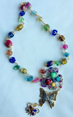 vintage-butterfly-brooches-on-a multi colores necklace