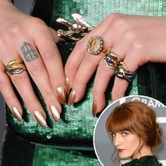 Florence Welch: Florence Welch wore bronze nail polish to complement her multicolored rings and green Givenchy gown.