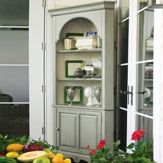 Distressed wood corner cabinet with 3 display shelves and a bottom storage cupboard. Product: Corner cabinetConstruction ...