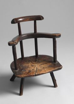 Welsh child's primitive comb back chair,  oak with traces of paint, circa 1750