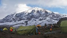 Budget travel adventures include cheap Kilimanjaro climbing tours and cheap hotels in Moshi, cheap hotels are quality and comfort...booking last minute budget Machame route at http://www.kilitraveladventurestz.com  Machame Camp (2980m) @ Kilimanjaro in Machame, Tanznania