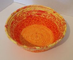A personal favorite from my Etsy shop https://www.etsy.com/listing/479685849/fabric-pottery-coiled-fabric-bowl-basket