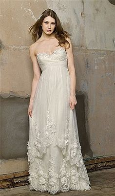 I LOVE this.  It's so simple, sweet, pretty, sexy, all in one.  Love the layers and the flowers, it's just the right amount of everything!   Jasmin Wedding Dress.