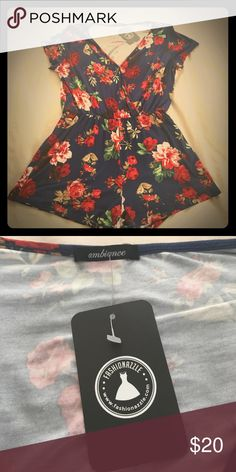 Flowered romper Flowered romper never worn. Just hit me a bit too short on the leg. I'm 5'11- so anyone with shorter legs would do great!  Loved this price as the only thing wrong was that it was too short for me. Ambiance Apparel Shorts