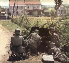 German soldiers operating a PAK 36 during the Battle of France. Re-Pinned by HistorySimulation.com