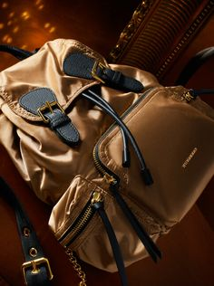 Our runway bag, The Rucksack, is available in festive gold with leather finishes.