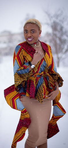 If you thought African print couldn't get better, you'd be surprised! Totally lusting on this handmade African print wrap blouse. The colors and style make a bold statement. Definitely not one for the faint of heart. Loving the contemporary twist with a j African Clothing For Men, African Dresses For Women, African Wear, African Women, African Outfits, African Style, African Tops, African Attire, African Print Fashion