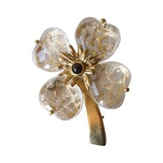 Goossens Paris Rock Crystal and Garnet Clover Pin | From a unique collection of vintage brooches at https://www.1stdibs.com/jewelry/brooches/brooches/