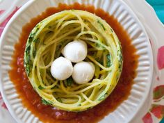 "In Giada's adorable Spaghetti Nests, bocconcini (small, fresh mozzarella balls) stand in for birds' eggs. Use tongs to swirl the cooked spaghetti, then transfer it to a prepared pan and bake until firm enough to hold the ""eggs."""