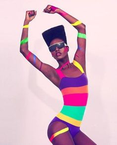 Grace Jones looking incredible in her multicolour horizontal stripe one piece. Body envy.