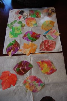Pretty coffee filter leaves - just coffee filters, a glue gun and water colors. Plus fingerprint tree ideas.