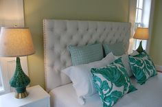 This master bedroom in aquas and emerald is accented with plush shams from HomeGoods. It's the perfect spot to accessorize a bed.