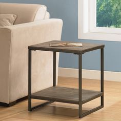 Offering the look of reclaimed wood, this Elements end table has a weathered grey oak finish. This table features non-mar foot glides and a storage shelf.